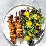 air fryer chicken kabobs served with a salad