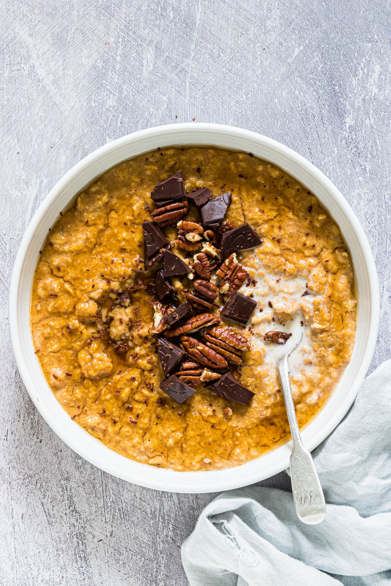 Instant Pot Pumpkin Oatmeal in a white bowl with a spoon