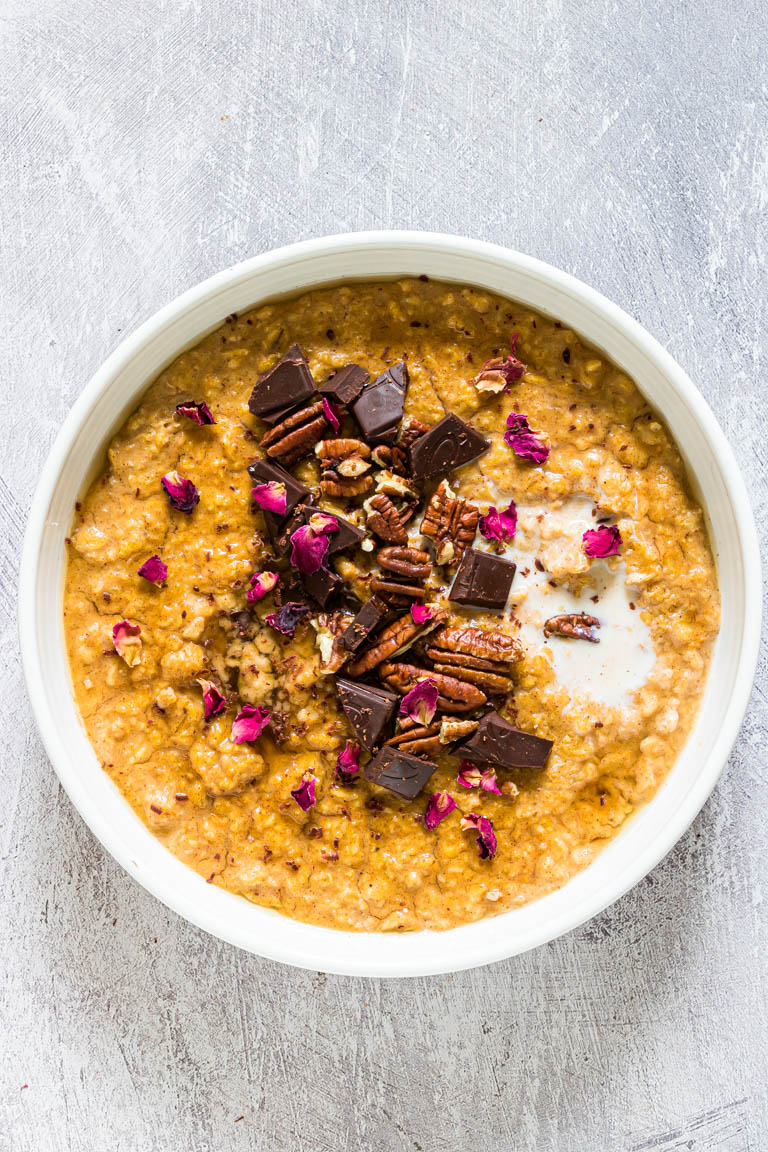 pumpkin oatmeal topped with nuts and chocolate