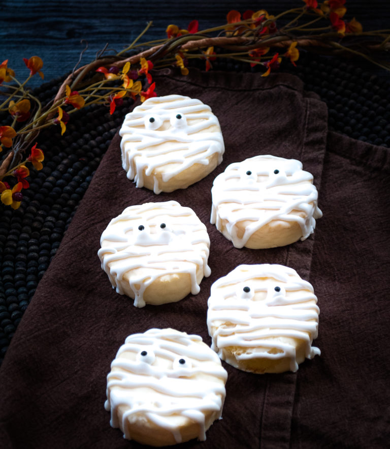 the finished Halloween mummy cookies on a cloth napkin