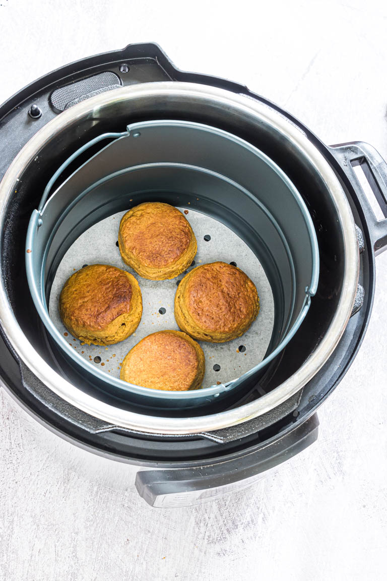 four instant pot biscuits inside the instant pot