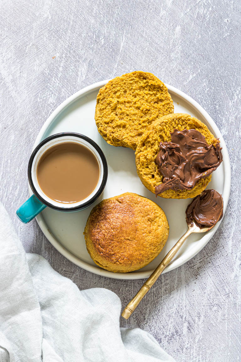 two air fryer biscuits served with pumpkin butter and a cup of coffee