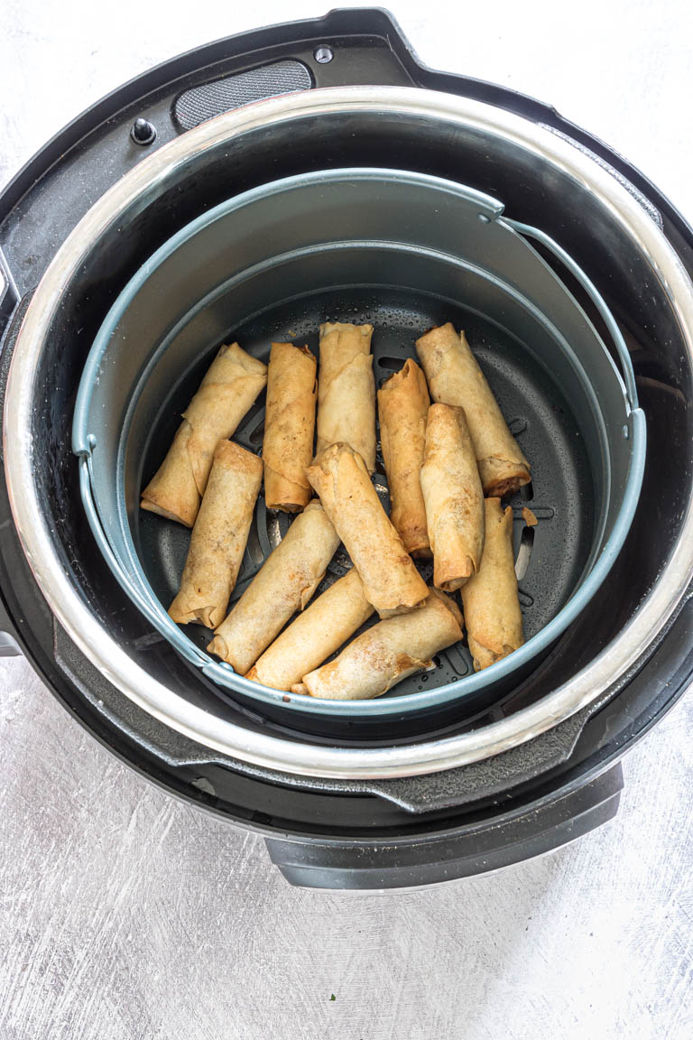 top down view of air fryer egg rolls inside the instant pot