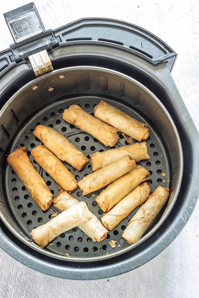 top down view of air fryer egg rolls inside the air fryer basket