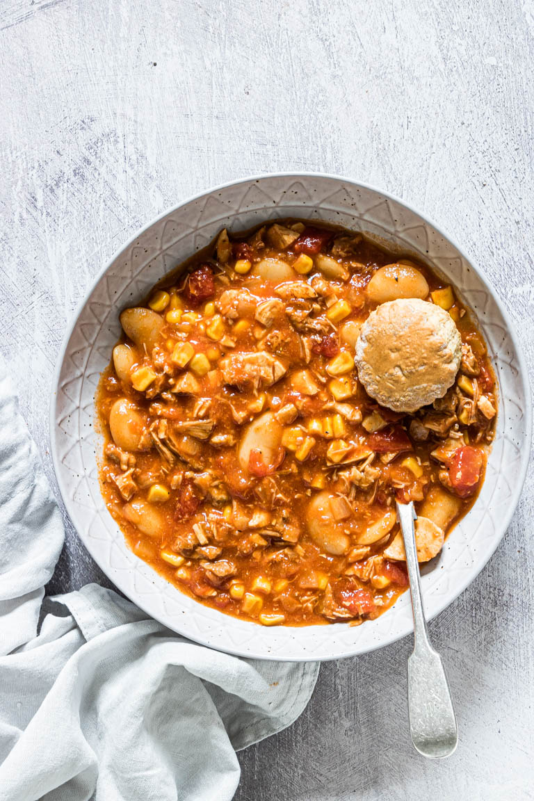 a bowl filled with brunswick stew and ready to be served