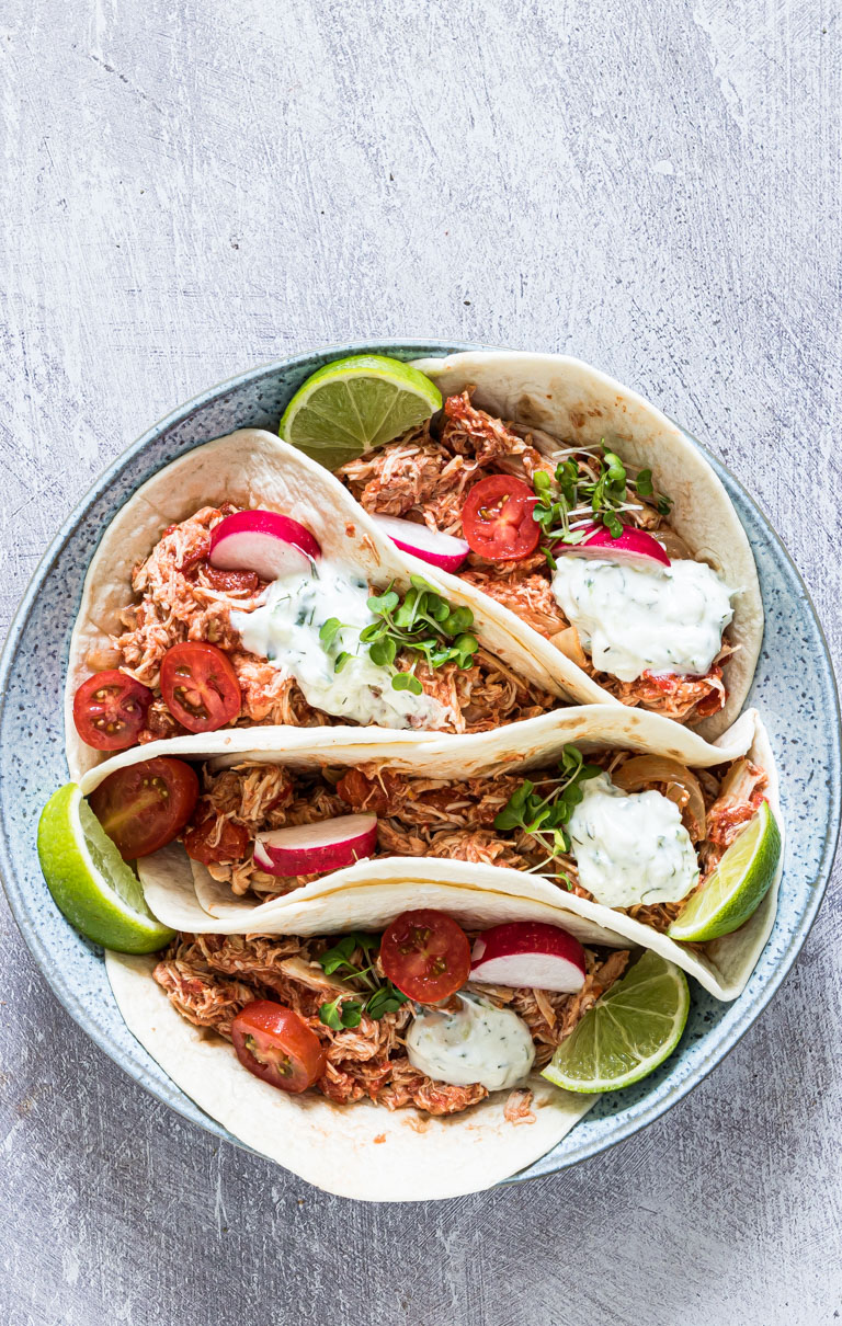 crockpot chicken fajitas served on a blue plate