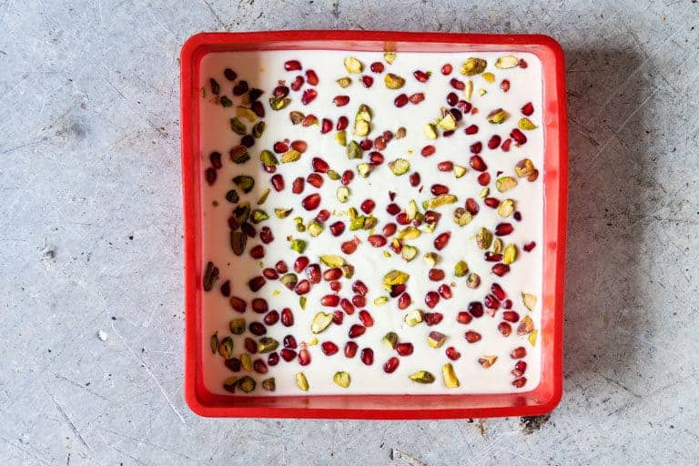 yoghurt, pistachios and pomegranate seeds mixed to make frozen yoghurt bark