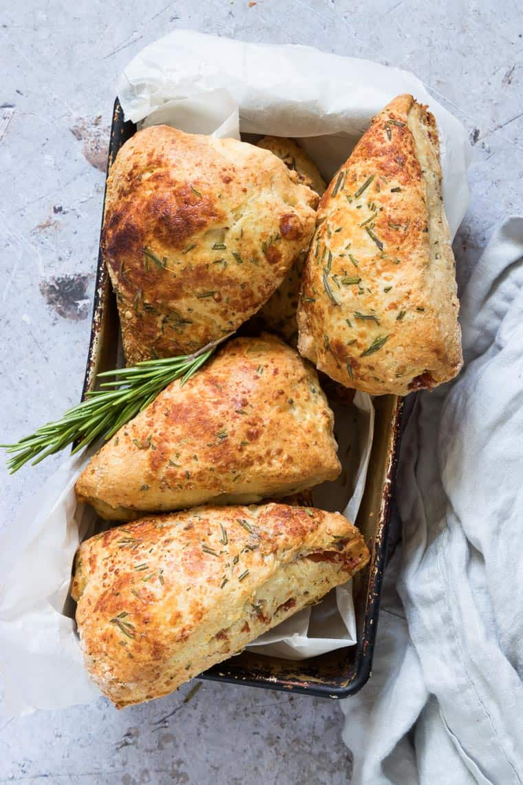 four ham parmesan and rosemary scones in a ceramic dish