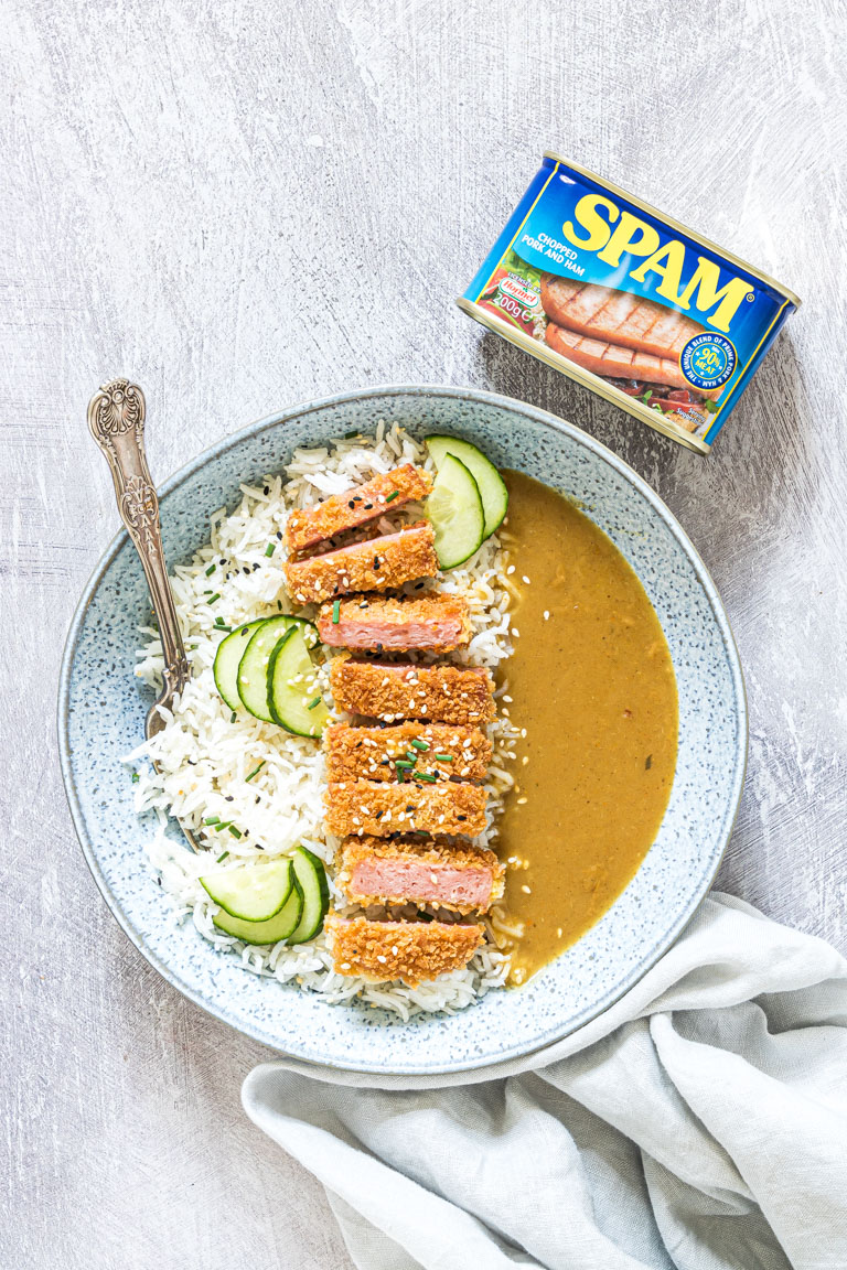 SPAM Fritters Katsu Curry served in a bowl with rice, a fork and a cloth napkin