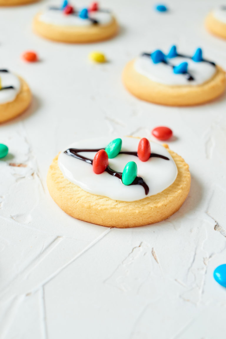 some of the decorated cookies on a countertop