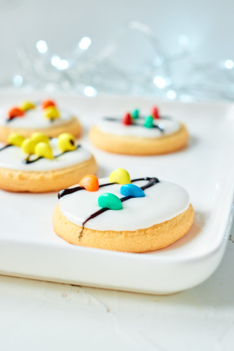 four of the completed Christmas Lights Cookies served on a white tray