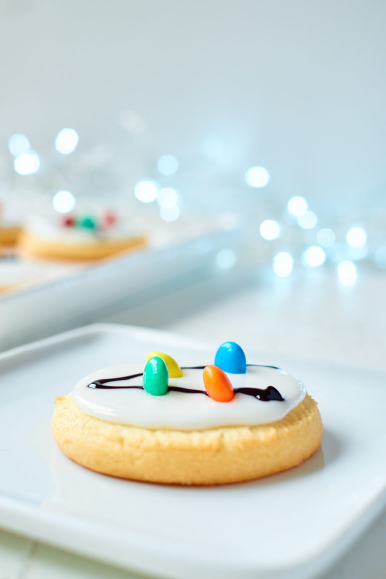 one of the Christmas Light Cookies served on a white plate