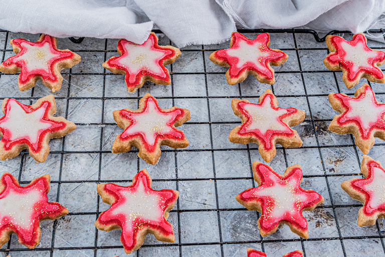 the decorated shortbread cookies on a cooling rack
