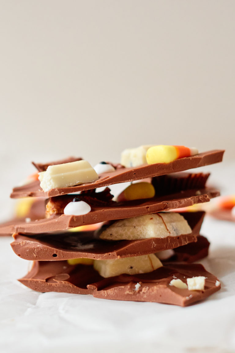 side view of pieces of halloween candy bark stacked on top of each other