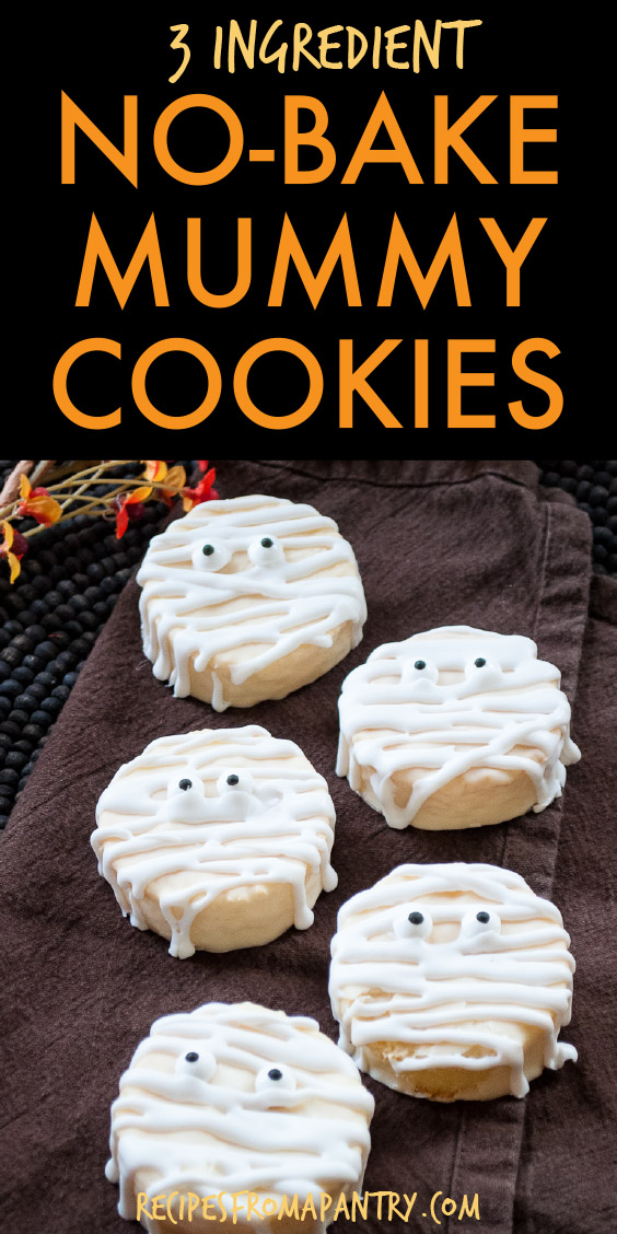 a row of 5 mummy cookies on a napkin