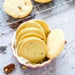 Pecan Shortbread Cookies served in a scalloped bowl