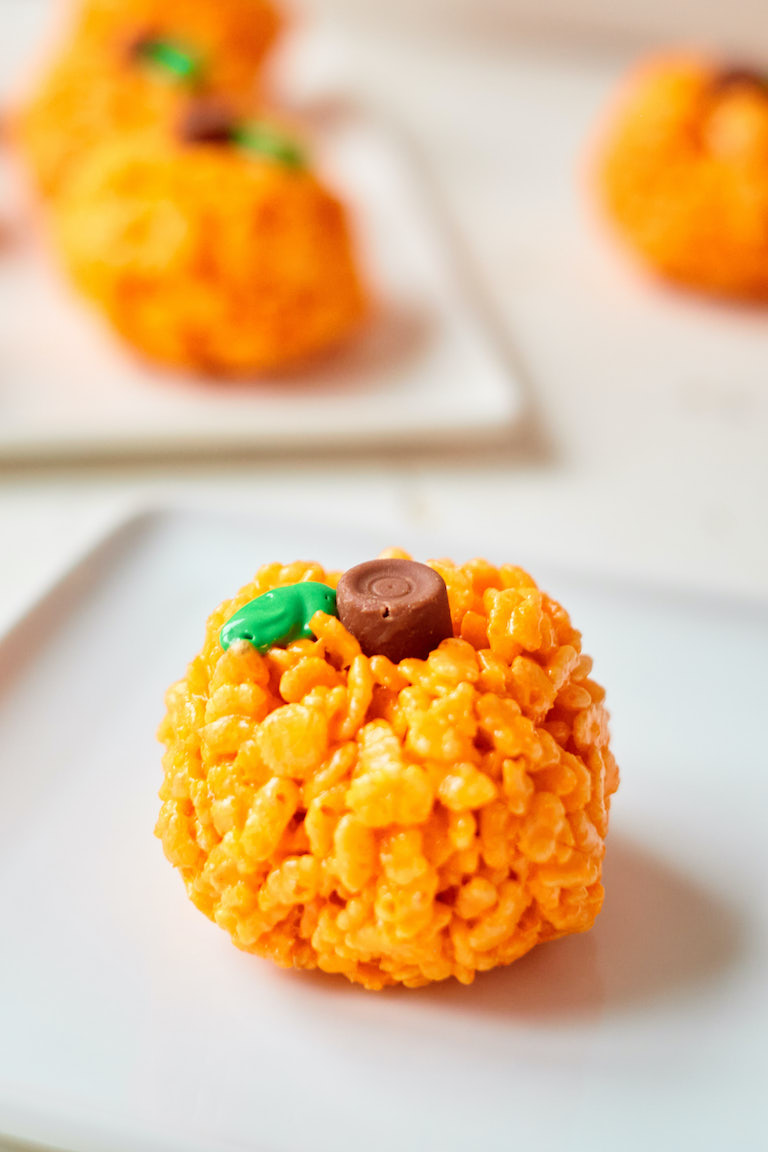 one of the finished pumpkin rice krispies on a white plate