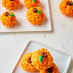 pumpkin rice krispie treats served on white square plates