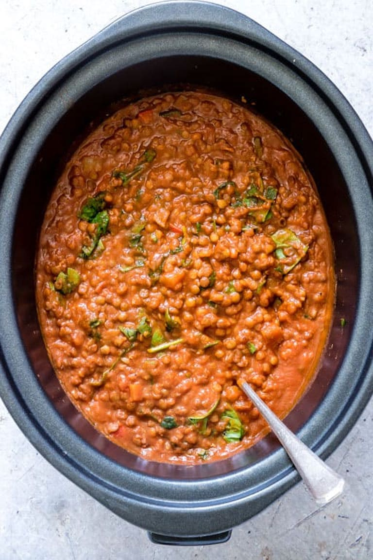 top down view of the finished lentil curry inside the crockpot