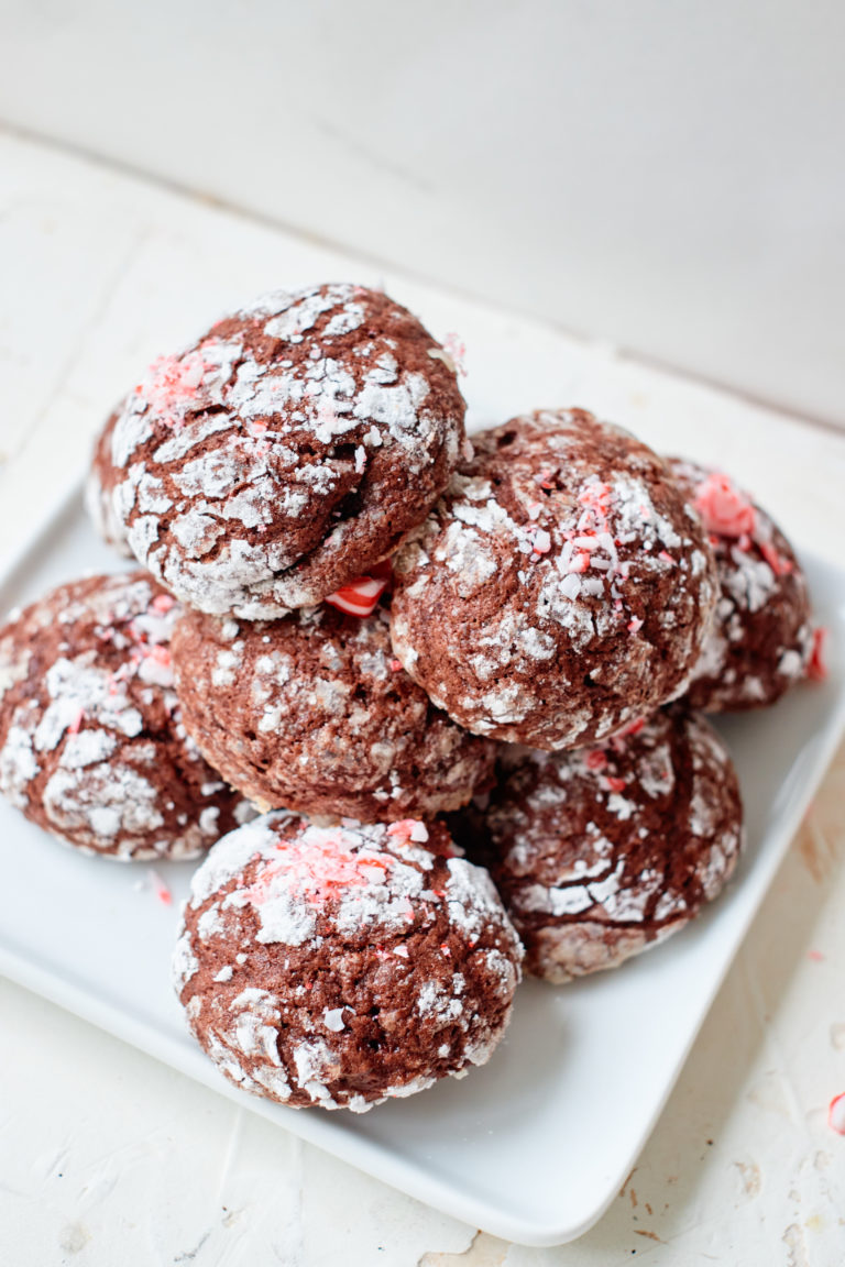 the completed crinkle cookies piled on a white plate