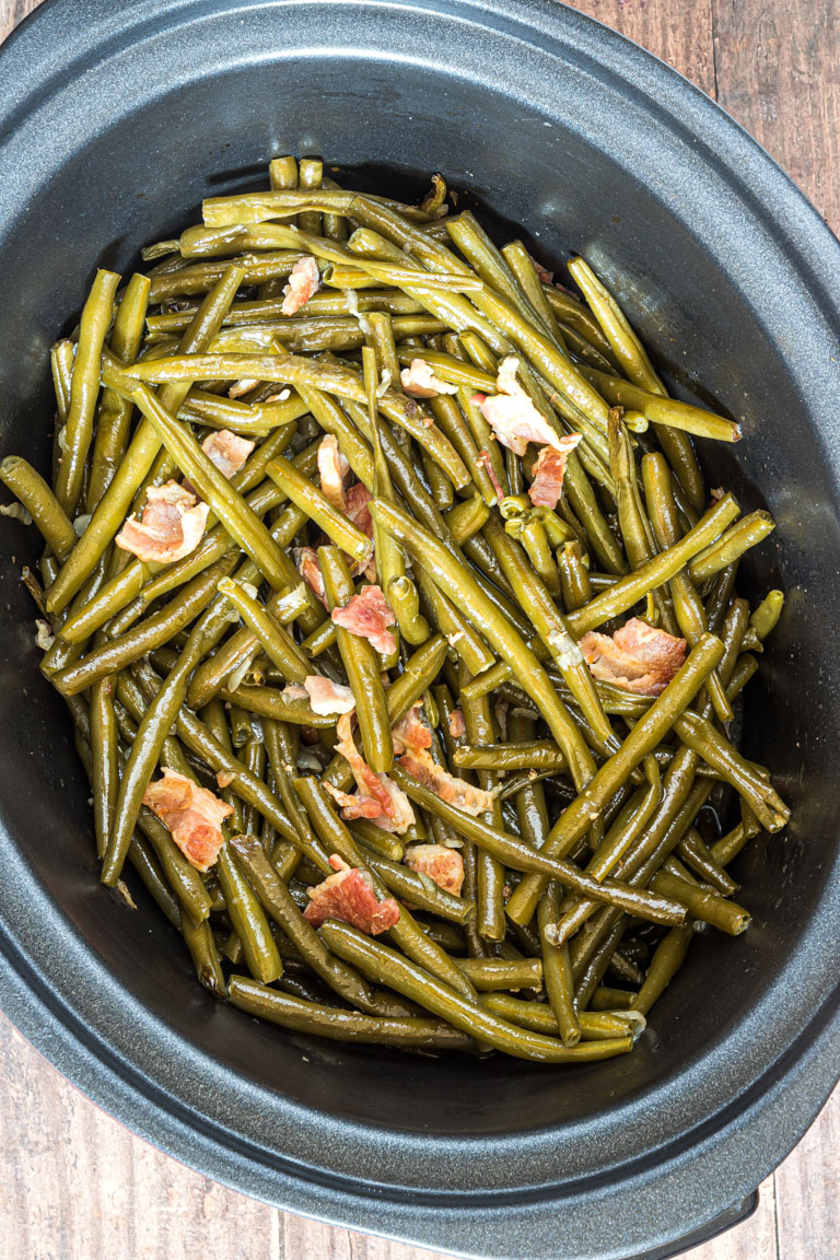 green beans and bacon inside the slow cooker