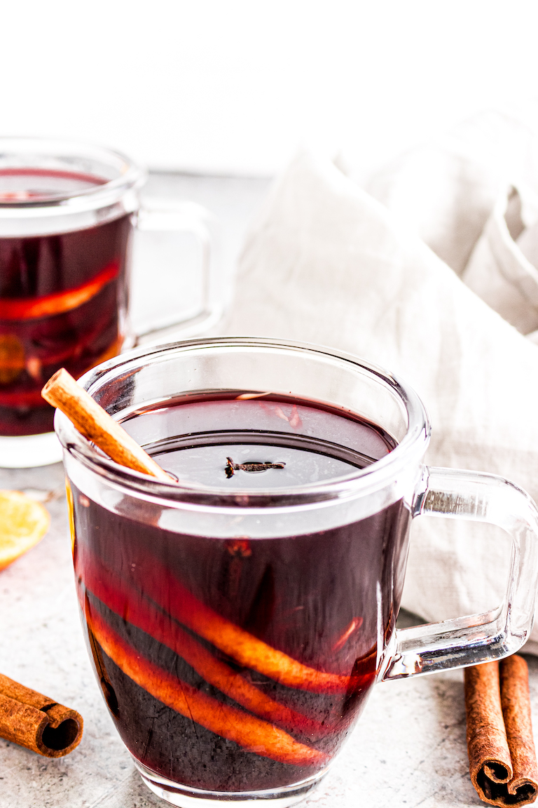 two glasses filled with the finished hot spiced wine recipe