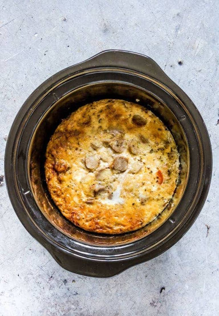 Top down view of the completed breakfast casserole inside the crockpot