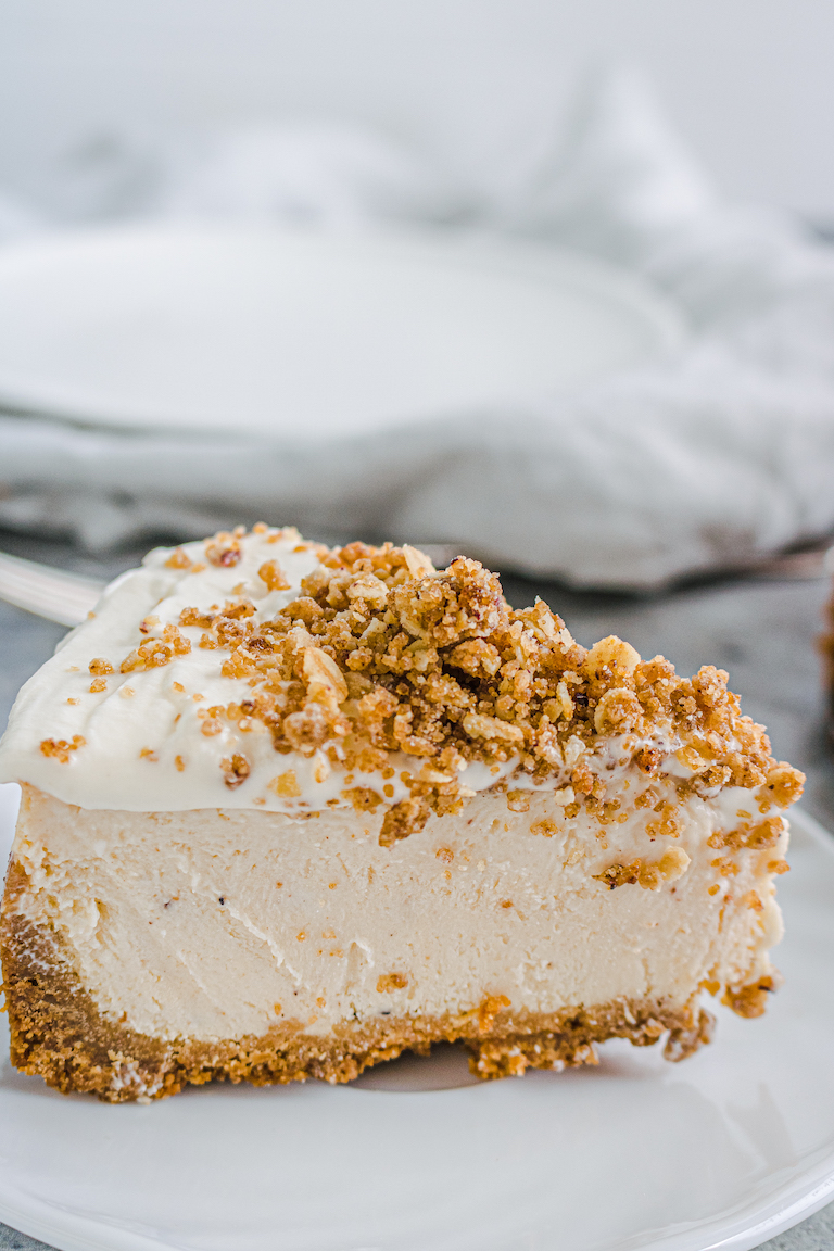 side view of a slice of the finished eggnog cheesecake