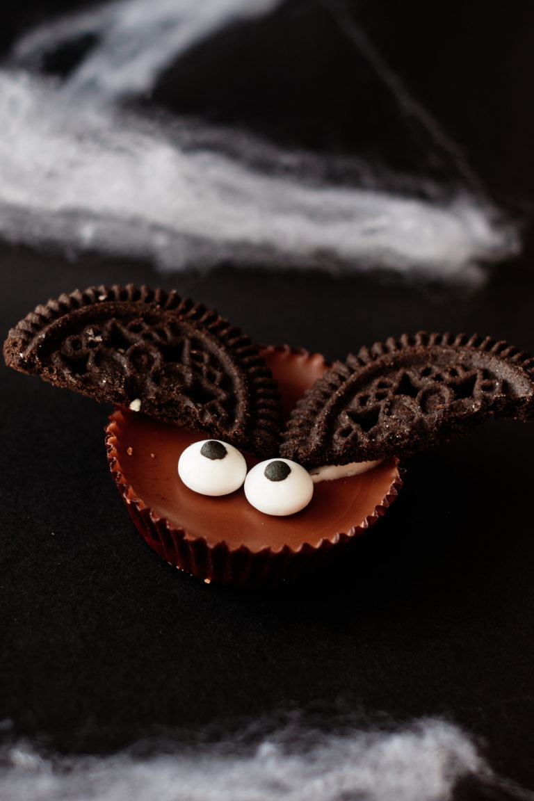 close up view of one finished halloween no bake bat cookie