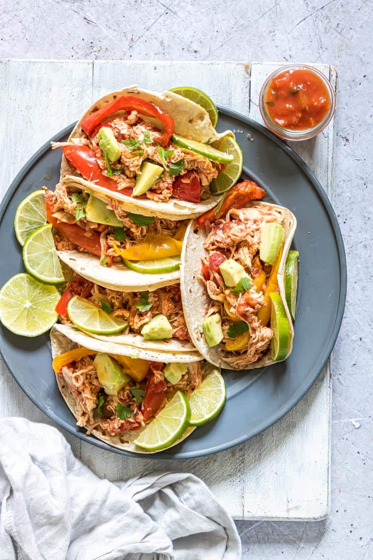a plate filled with instant pot chicken fajitas