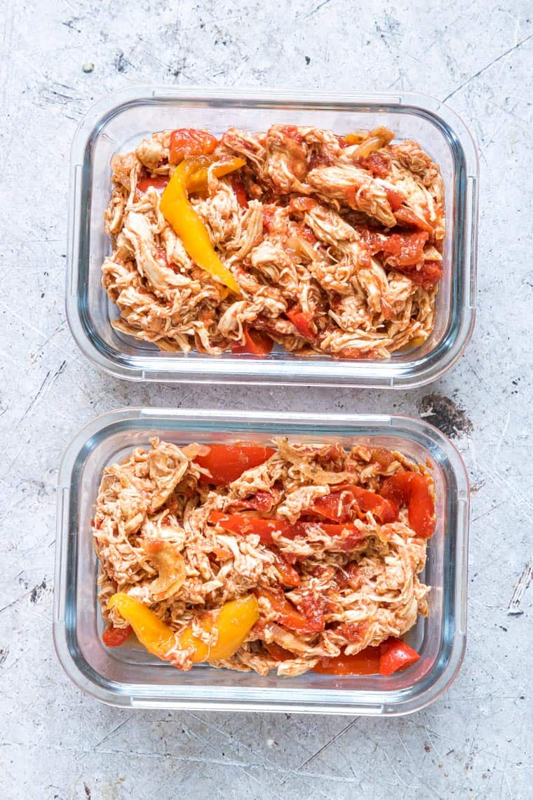two glass meal storage containers filled with instant pot chicken fajitas filling