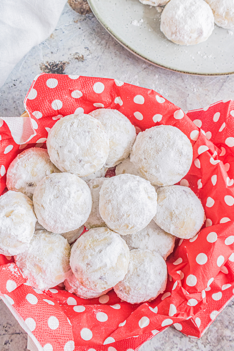 the finished snowball cookies packaged in red polka dot paper