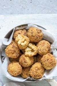 a batch of air fried mac and cheese balls ready to be served
