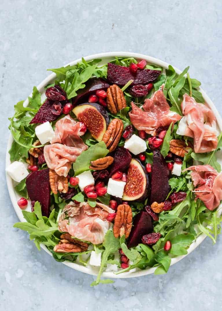 Assembled Parma Ham and beet Salad on a large white plate