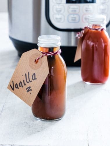The completed Instant Pot Vanilla Extract packed in individual bottled and tied with handwritten gift tags