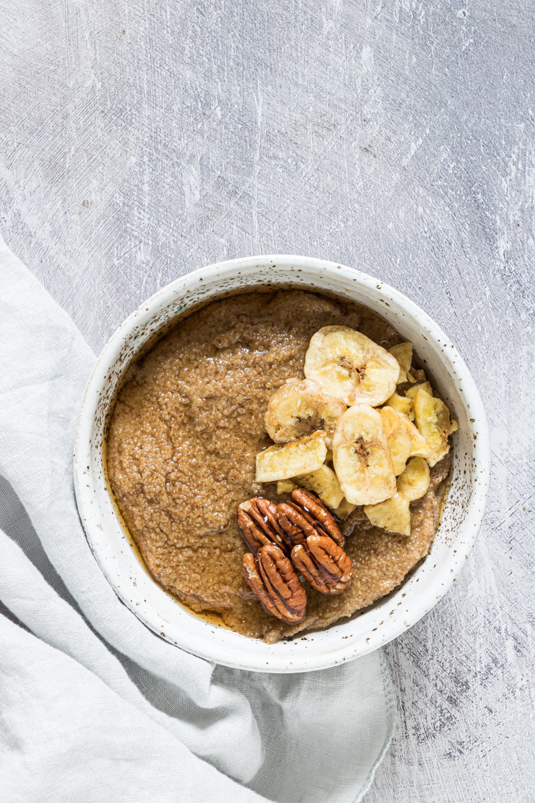the finished porridge in a bowl and topped with sliced banana and walnuts