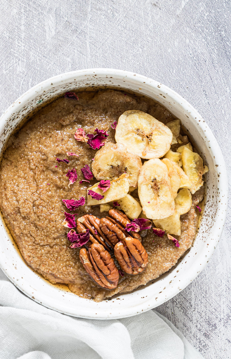 close up view of porridge made with teff served in a ceramic bowl