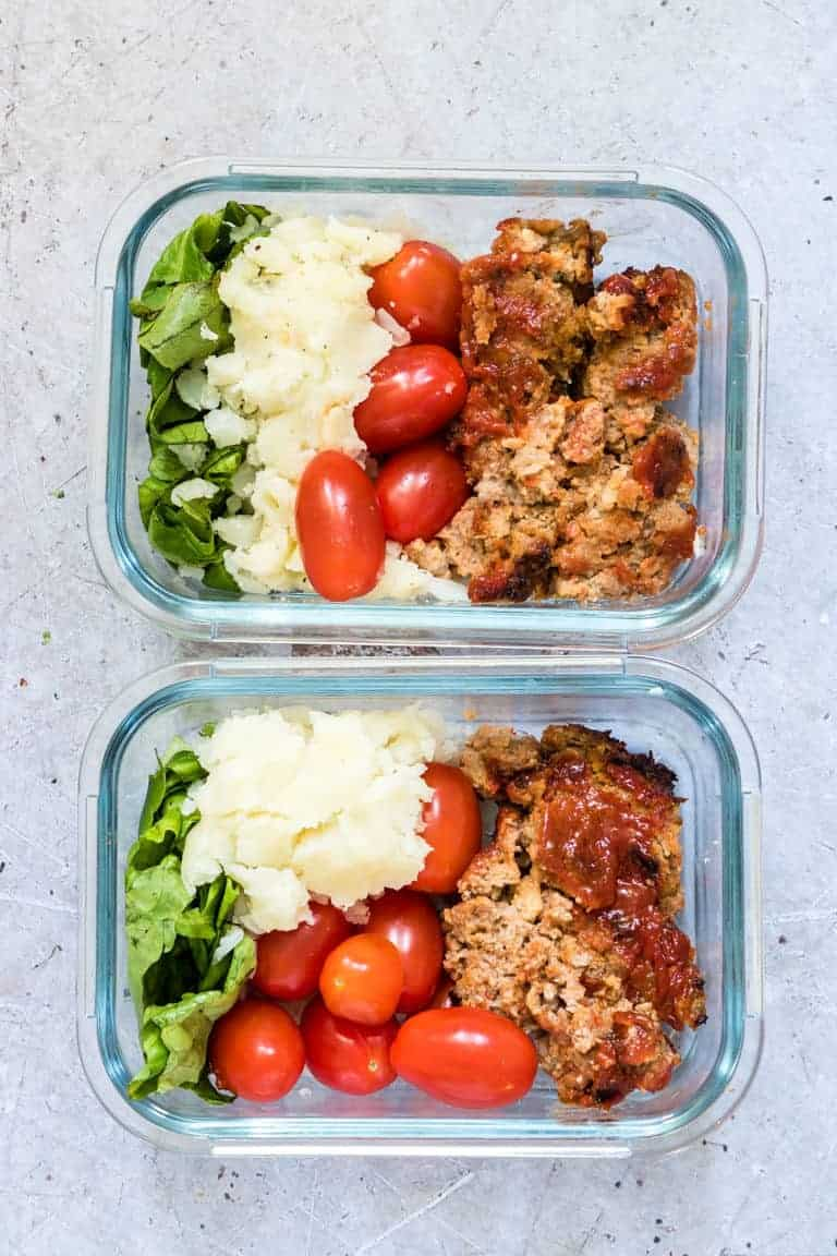 Air fryer meatloaf in a meal prep bowls with mashed potato, lettuce and tomatoes