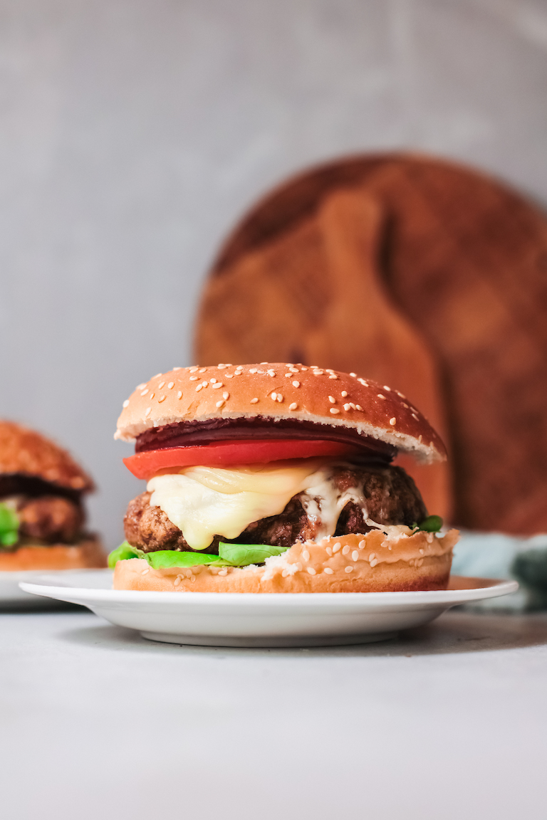 the completed air fryer turkey burgers recipe served on white plates