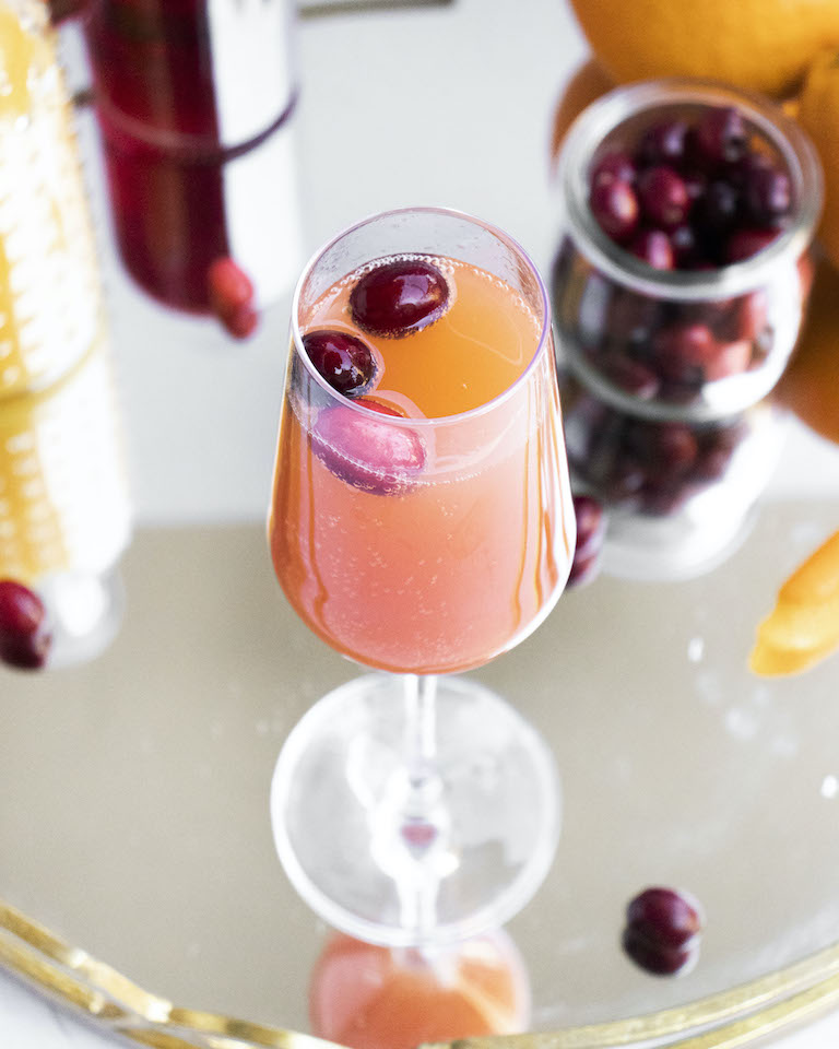 top down view of a completed mimosa garnished with fresh cranberries
