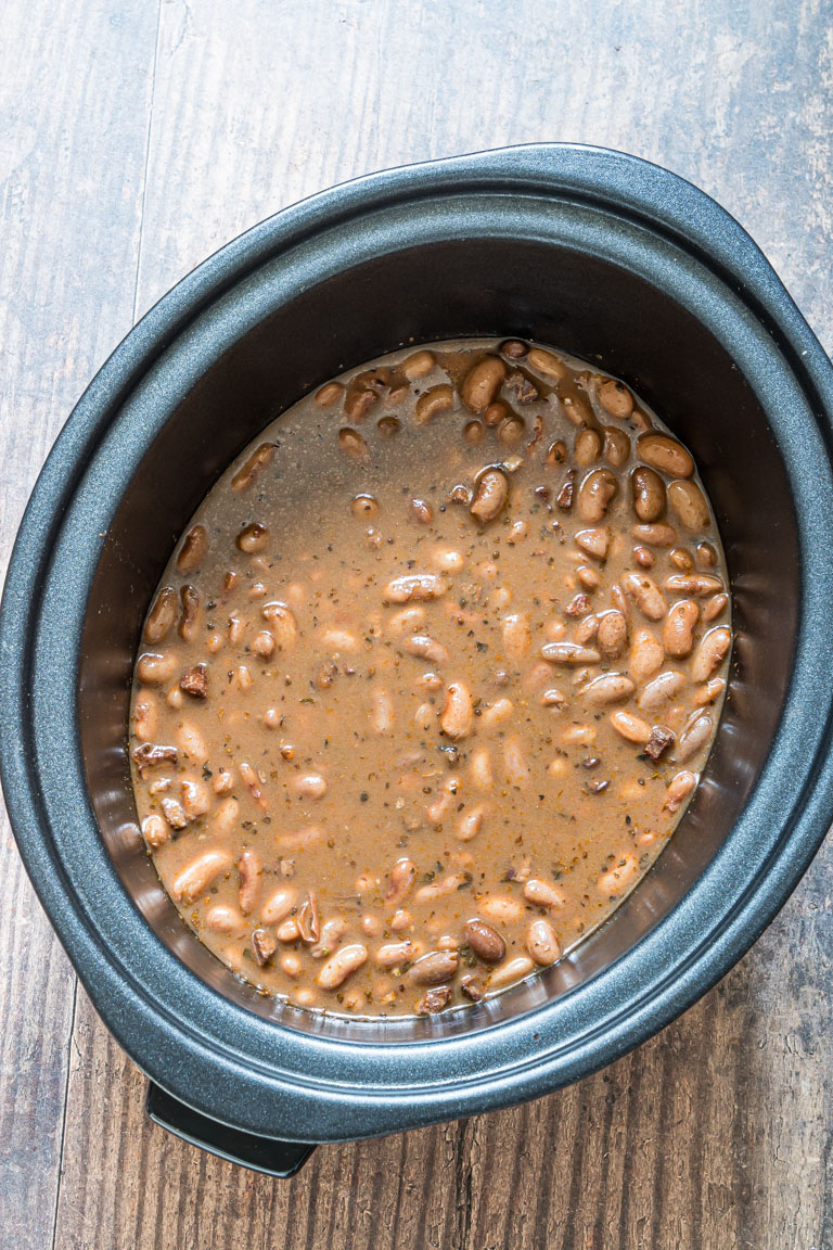 cooked pinto beans inside the crock pot