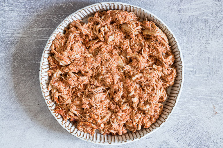 the shredded chicken in a ceramic dish and ready to be served