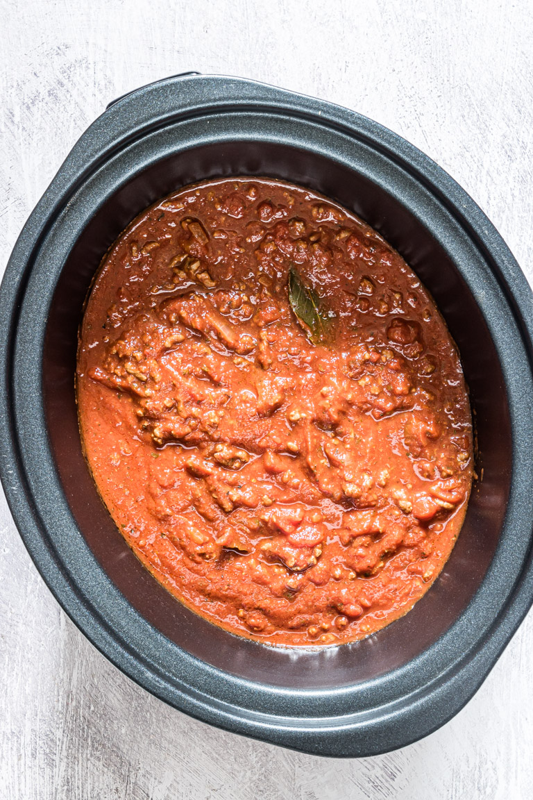 the finished slow cooker pasta sauce inside the crockpot and ready to serve