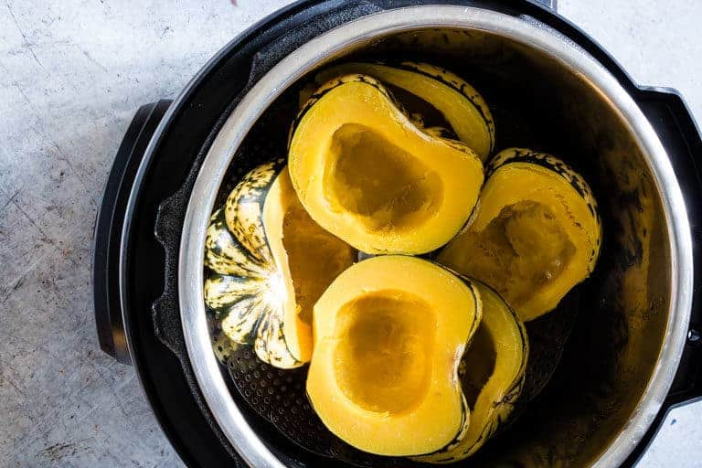 Cooked Dumpling squash inside the Instant Pot and ready to be made into stuffed squash