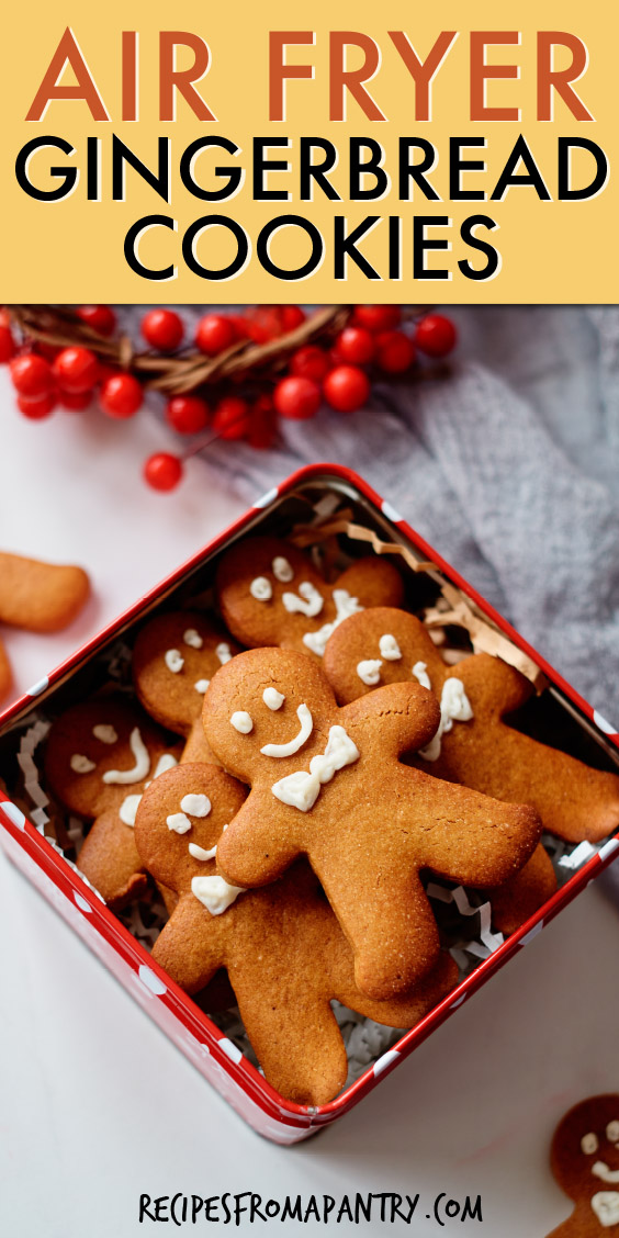 gingerbread man cookies inside a holiday tin