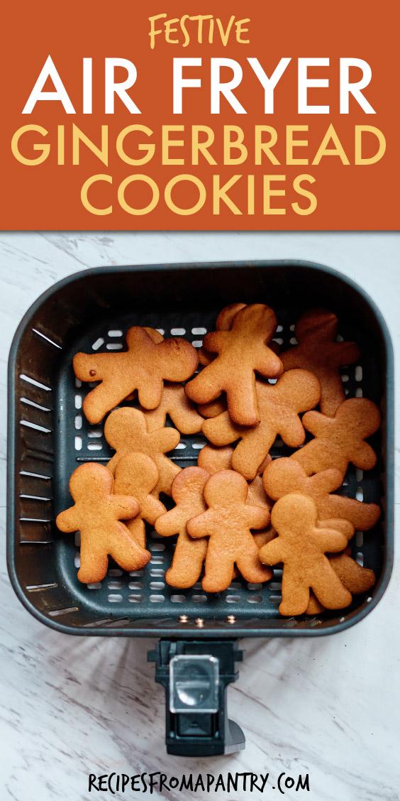 Gingerbread man cookies inside an air fryer basket