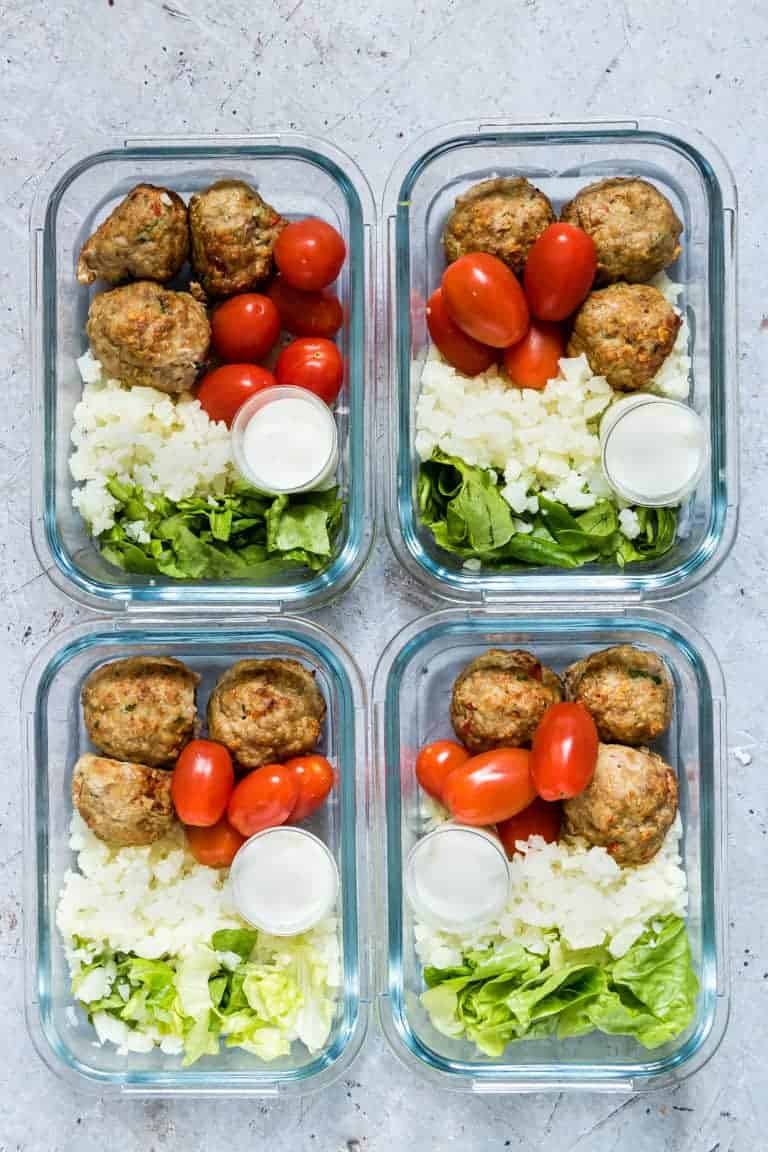 air fryer meatballs in meal prep bowls with cauliflower rice, lettuce and tomatoes