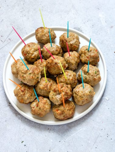 Air Fryer Meatballs (Turkey Meatballs) on a plate with coloured toothpics