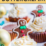 a gingerbread cupcake topped with a gingerbread man