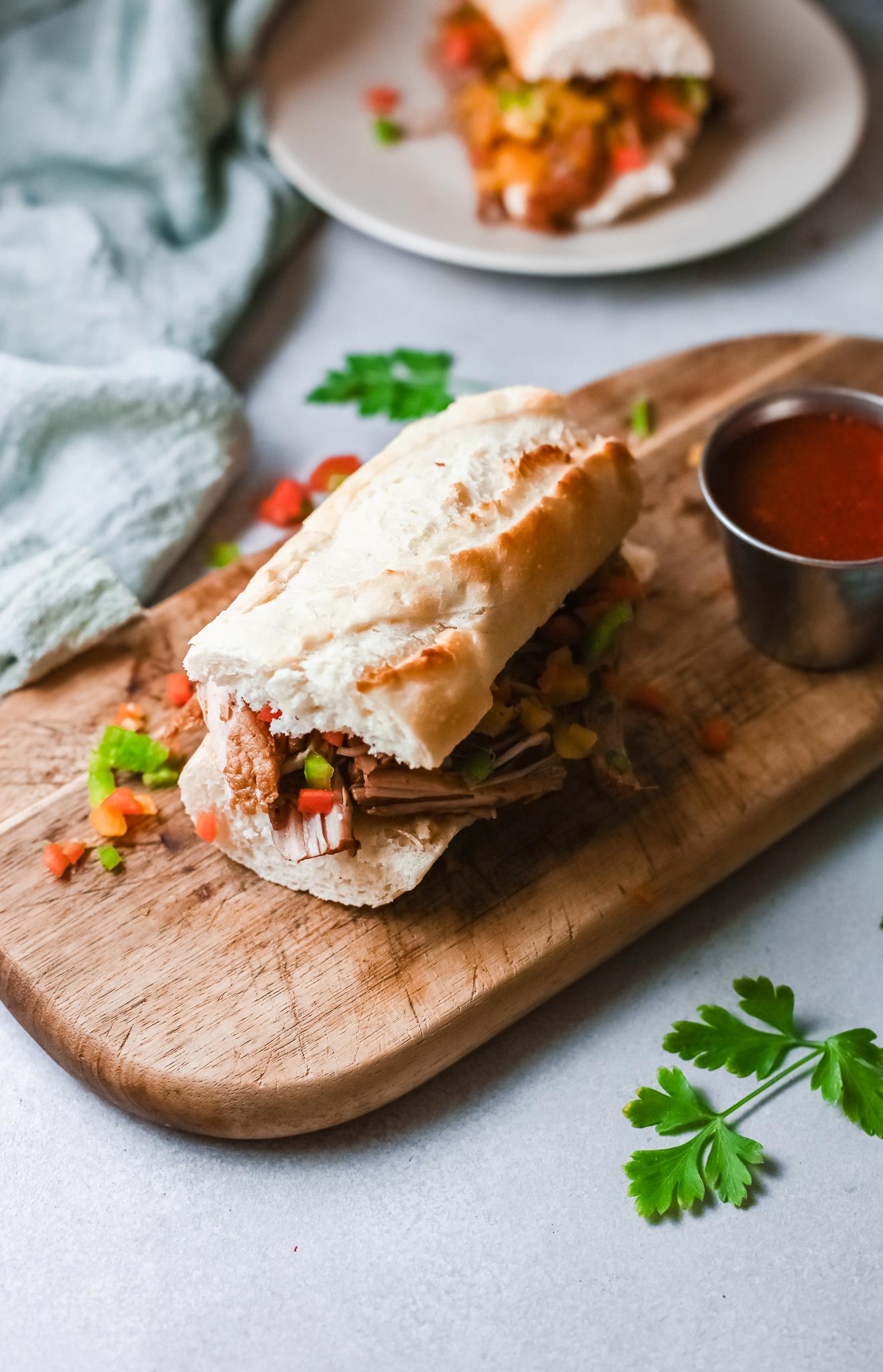instant pot italian beef sandwich served on a cutting board